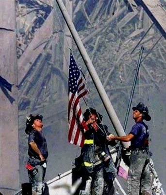 Firefighters raising the Flag on September 11th