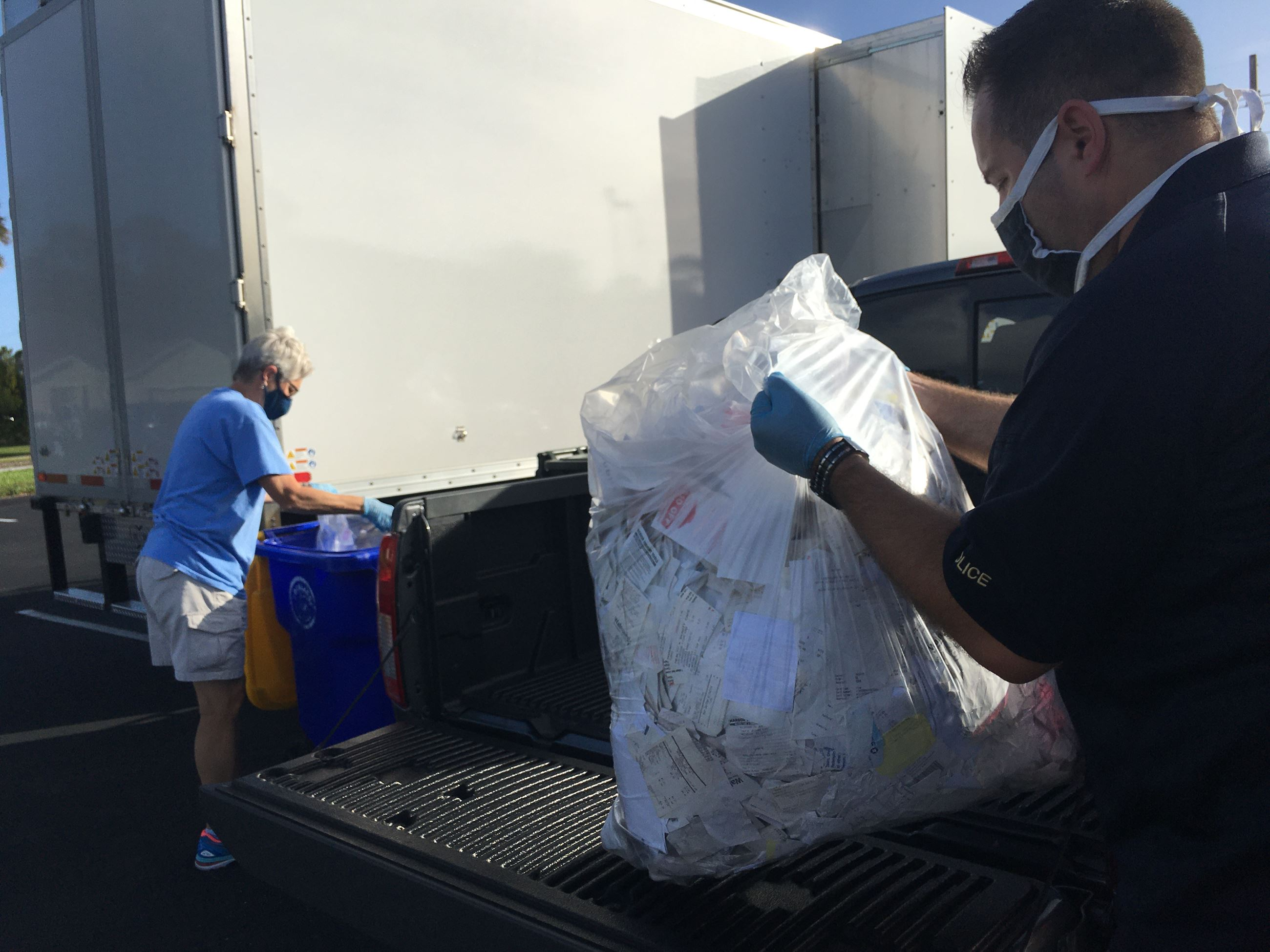 Lt. Crawford and City Manager Fettrow collecting documents to shred