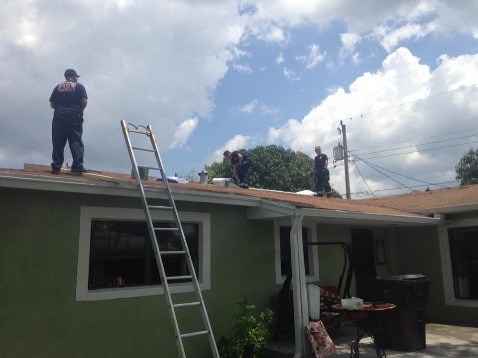 Two firefighters on a roof